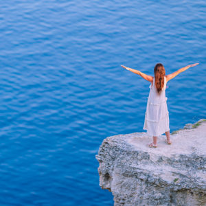 Woman on the edge of a cliff
